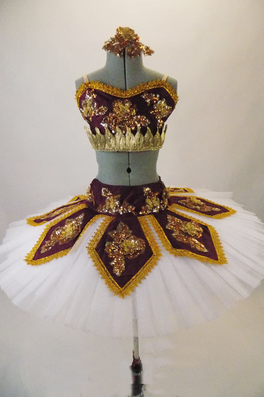 Professional hooped & tacked pleated tutu has a burgundy peaked overlay and basque with 3-D gold floral beaded appliques & brocade edging. Matching bodice half-top has gold leaf band & gold floral applique. Comes with a gold appliqued hair accessory. Front