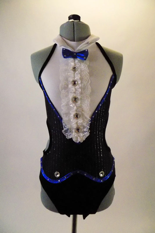 Classic Fosse-inspired open back and sides with double banded back strap. The costumes pops with blue piping, pin-striped coat-tail accents and ruffled bid with jewelled buttons and peaked lapel collar. The costume comes with a black tall bowler hat and matching jewel accented wrist cuffs. Front
