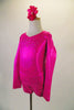 Long sleeved hot pink metallic marbled short unitard has crystalled front and back accents. The open back has a fully crystalled bow that rests at the base of the lower back. Comes with a hair accessory. Side