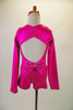 Long sleeved hot pink metallic marbled short unitard has crystalled front and back accents. The open back has a fully crystalled bow that rests at the base of the lower back. Comes with a hair accessory. Back