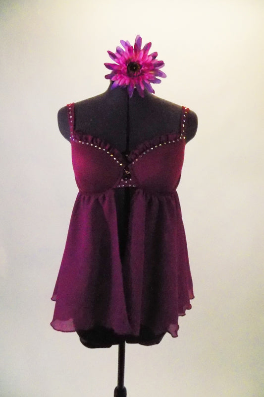 Purple baby-doll top has an open front with a cupped bra (34B) accented with crystals and ruffles. The top comes with accompanying purple shorts and matching floral hair accessory. Front