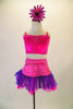 This sweet two-piece costume has pink half a top with crystal accents at front and back. The accompanying skirt has tone on tone pink striped patterns with a wide pink and purple tulle ruffle edge. Comes with pink/purple daisy hair accessory. Front