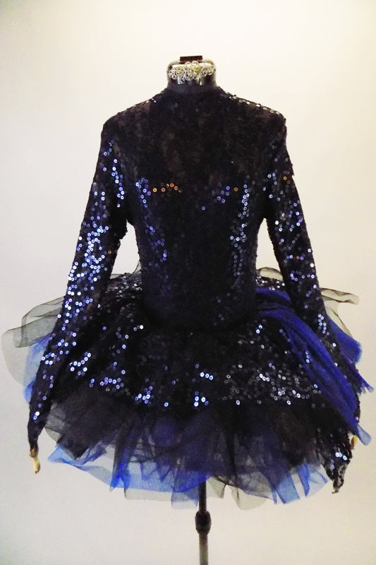 3-piece costume is a navy/royal blue full sequined leotard with long sleeves & key-hole back. The leotard is accompanied by navy shorts with sequin & chiffon cascading sashes at the right hip. There is a pull-on tutu skirt with stiff black & blue tulle layers with a sequined overlay. Comes with hair accessory. Front
