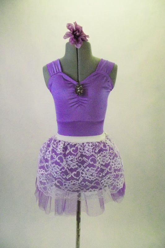 Pale lavender leotard has pinch front with jewelled brooch accent and wide shoulder straps. The matching lavender tulle and white lace pull-on skirt. Completes the pretty look. Comes with matching floral hair accessory. Front