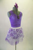 Pale lavender leotard has pinch front with jewelled brooch accent and wide shoulder straps. The matching lavender tulle and white lace pull-on skirt. Completes the pretty look. Comes with matching floral hair accessory. Side