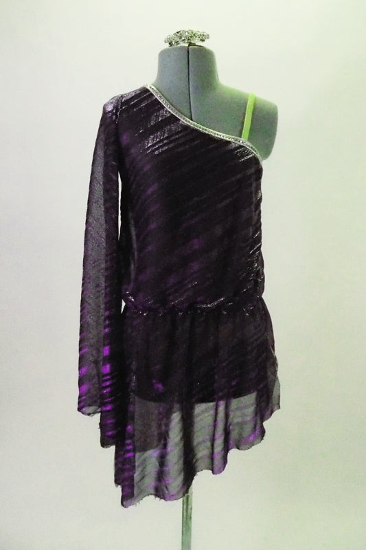 Purple and black iridescent striped shirt dress has one shoulder, nude strap and long sleeve. The silver piping and gathered waistband create a nice line. Comes with crystal hair barrette. Front