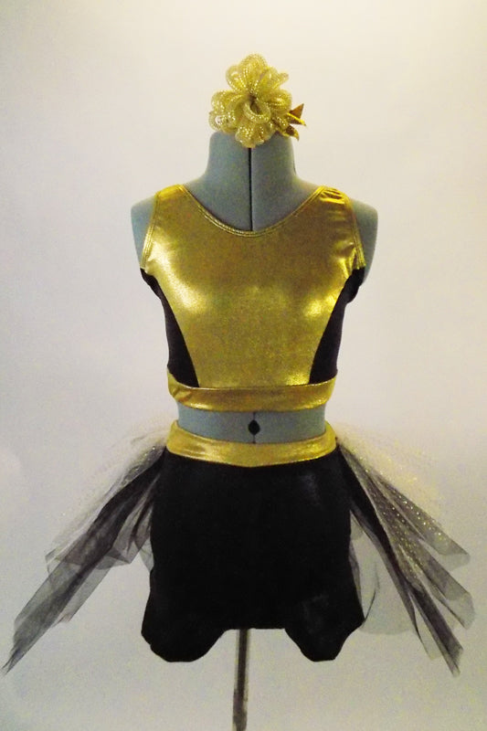 Gold & black two-piece costume has a gold and black half top. The bottom is black shorts with gold waistband and attached black-white-gold tulle bustle skirt.Comes with matching gold hair accessory. Front