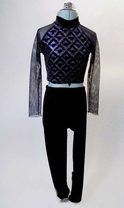 This modern two-piece costume has black velvet pant is paired with a silver and black high neck, geometric print half top with long fishnet sleeves and open back. Comes with a silver hair accessory. Front