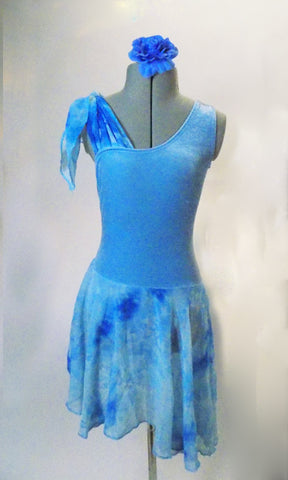 Blue velvet dress has one shoulder tank style with marbled crinkle chiffon tie-up on the other shoulder. The skirt is matching crinkle chiffon with attached brief below. Comes with a hair accessory. Front