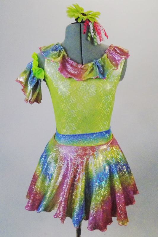 Iridescent dress has pale green bodice with rainbow coloured ruffles around the neckline and matching skirt. The neon green petticoat gives the skirt a nice fullness.  Comes with matching ruffled armband floral hair accessory. Front