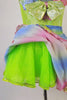 Iridescent dress has pale green bodice with rainbow coloured ruffles around the neckline and matching skirt. The neon green petticoat gives the skirt a nice fullness.  Comes with matching ruffled armband floral hair accessory. Skirt petticoat