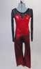 Two-piece costume has a long mesh sleeved top with sheer black upper and metallic red bodice with angled bust-line and crystal accents. The matching red pull-on pants complete the look. Front