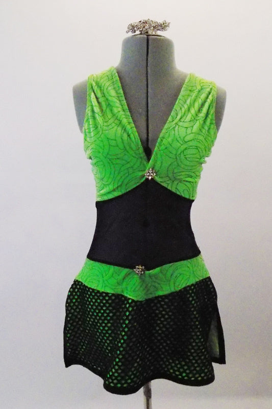 Black mesh and green velvet sparkle velvet costume has a black large meshed skirt and wide crossed back straps. Has crystal details at bust and waist. Comes with long mesh gauntlets and crystal hair barrette. Front
