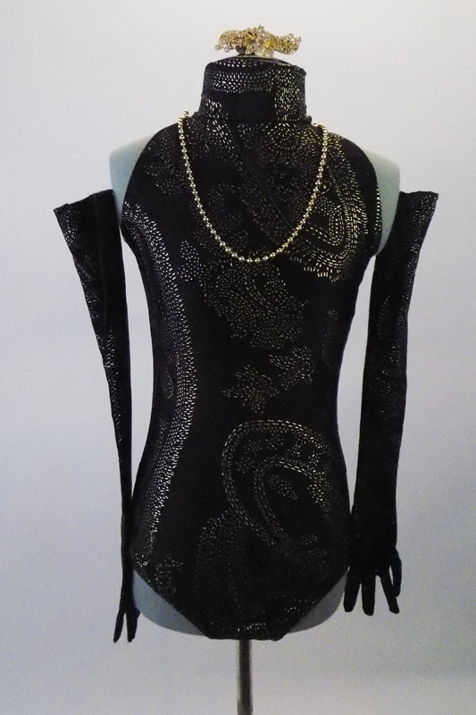 Black leotard has a high necked halter collar and an open back. The textured gold pattern is an intricate design of paisley reminiscent of the 1930s and is accented by an attached strand of gold pearls Comes matching Long gloves and a gold and crystal hair barrette. Front