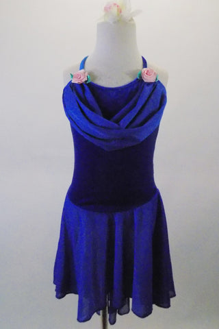 Royal blue camisole leotard dress has velvet bodice with chiffon cowl neck and high-low skirt. Pink roses accent the bust. Comes with a matching floral hair accessory. Front