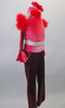 Funky, 3-piece costume has red metallic pants with coral pink glitter velvet waistband and cuffs. The open back velvet halter half-top has red marabou feather collar. The matching metallic gauntlets have feather cuff and ruffled velvet upper arm accent. Comes with a floral hair accessory. Side