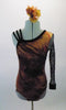 Wild brown velvet animal print leotard has single stretch mesh long sleeve. The right shoulder has three angled velvet straps for an asymmetrical effect.  Comes with a hair accessory. Front