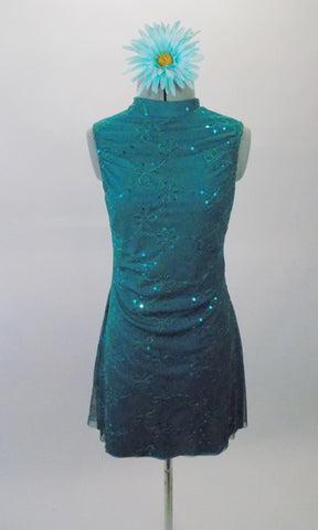 Lovely teal chiffon tunic dress has a delicate floral pattern with sequined accents. The open keyhole back gives it a revealing flare. Comes with a floral hair accessory. Front