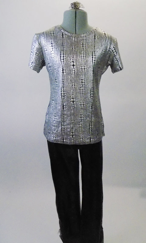 Silver textured top with round neck and short sleeves is complemented by black pants with black and silver lacing up the outside of the lower leg. Comes with a silver hair clip. Front