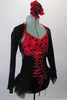 Gorgeous leotard with corset lace up front and open back had red and black polka dot bust and black sequined bottom with layered bustle skirt. The black sequined mini shrug with matching red piping sits on shoulders just above the bra leaving the lower back exposed. Right side