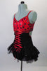 Gorgeous leotard with corset lace up front and open back had red and black polka dot bust and black sequined bottom with layered bustle skirt. The black sequined mini shrug with matching red piping sits on shoulders just above the bra leaving the lower back exposed. Left side