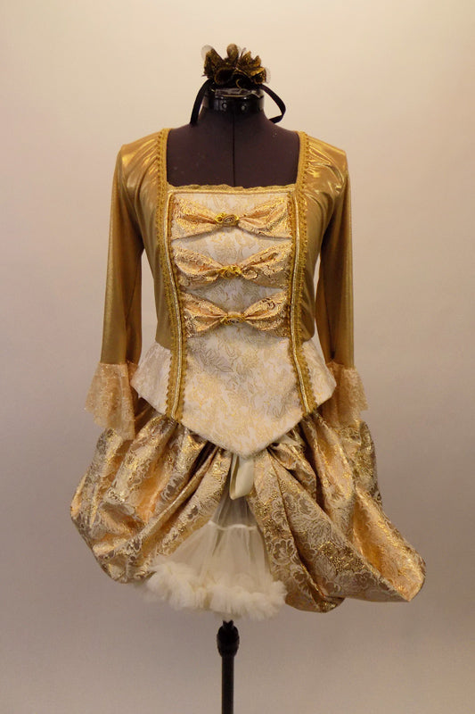 "Baroque gold ballet costume has gold brocade over-lay that reveals a ruffled petticoat. The gold 3/4 sleeved top has brocade ruffle & gold bows. The front bodice has princess cut ""V"" front with peplum and brocade center panel accented with gold bows and grommet back lace back. Front"