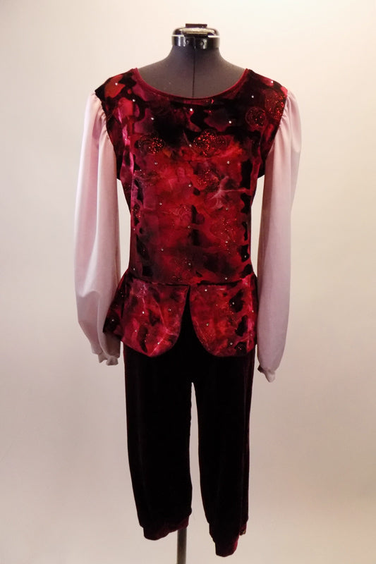 Two-piece costume has a medieval fairy-tale theme. The burgundy cuffed knicker pants compliment the burgundy floral tunic peplum top with pink chiffon long pouffe sleeves and crystal accents. Front