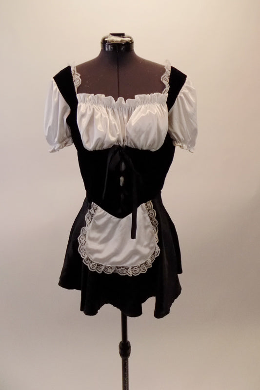 Black and white French maid costume has black velvet upper and satin skirt. The torso has an under-bust lace corset beneath a with gathered blouson bust and pouffe sleeves. Comes with a separate bottom and attached apron. Front