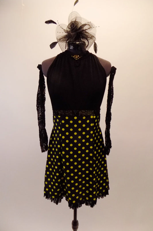 Black gathered halter bodice has greenish crystal accents at high neck and lime yellow polka dots skirt with lace waistband. The matching lace gauntlets and black headband accessory completes the look. Front
