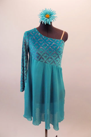 Turquoise long single sleeved, off shoulder A-line dress, has velvet glitter pattern sleeve and bodice with chiffon skirt.  The neckline is lined with crystals and nude elastic reinforces the left shoulder. Comes with a floral hair accessory.  Front