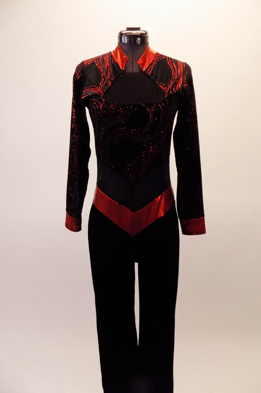 Long sleeved unitard is a black velvet base and zip back. The top portion has glitter swirls and red mandarin collar and cuffs. The waist is a sheer black mesh with shiny red band that comes to a point. Comes with a hair accessory. Front