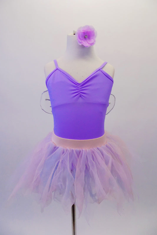 Pale lavender leotard has pinched front and comes with a pale pink pull-on chiffon fringe ballet skirt. Sheer white and silver fairy wings pin to the back. Comes with a lavender floral hair accessory. Front