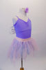 Pale lavender leotard has pinched front and comes with a pale pink pull-on chiffon fringe ballet skirt. Sheer white and silver fairy wings pin to the back. Comes with a lavender floral hair accessory. Side