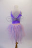 Pale lavender leotard has pinched front and comes with a pale pink pull-on chiffon fringe ballet skirt. Sheer white and silver fairy wings pin to the back. Comes with a lavender floral hair accessory. Back