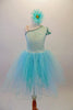 Delicate pale aqua romantic tutu dress has a single shoulder sparkle bodice with sequined trim and butterfly sleeves. Multiple layers of soft aqua tulle comprise the skirt. Comes with a floral hair accessory. Front
