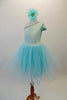Delicate pale aqua romantic tutu dress has a single shoulder sparkle bodice with sequined trim and butterfly sleeves. Multiple layers of soft aqua tulle comprise the skirt. Comes with a floral hair accessory. Left side