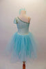 Delicate pale aqua romantic tutu dress has a single shoulder sparkle bodice with sequined trim and butterfly sleeves. Multiple layers of soft aqua tulle comprise the skirt. Comes with a floral hair accessory. Back