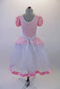 Delicate romantic tutu dress has pale pink lace bodice and overlay with pouffe sleeves, lace trim and wide gathered waistband. The long white tulle skirt has a pink satin ribbon trim.  Comes with matching floral hair accessory. Back
