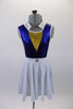 Naval themed two-piece costume has a royal blue metallic effect leotard with triangular gold inlay at bust. The white naval collar compliments the accompanying knee length skirt with crystal anchor detail. Comes with matching captain's hat. Front