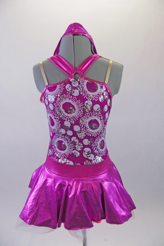Sweet two-piece costume has white circular sparkle pattern on the bodice of a metallic pink base. The hater neck straps originate from a ring at the front of the bodice. The accompanying pull-on skirt is metallic pink with white tulle for volume. Comes with a purple floral hair accessory. Front