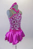 Sweet two-piece costume has white circular sparkle pattern on the bodice of a metallic pink base. The hater neck straps originate from a ring at the front of the bodice. The accompanying pull-on skirt is metallic pink with white tulle for volume. Comes with a purple floral hair accessory. Side