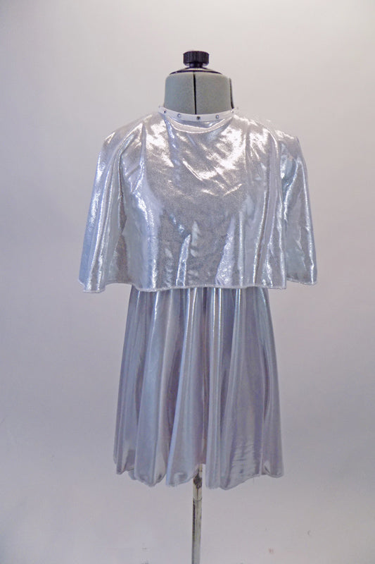 Soft and light silver flowing dress is simple with round neckline and empire waist. It comes with a crystalled silver removable poncho.  Front