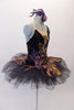 Peacock themed ballet tutu has a black base with beautiful gold & purple embroidered lace designs on the bodice & sheer overlay. The nude straps cross over at the back for good support. The accompanying black pull-on tutu & black briefs create the stunning base. Comes with a large matching hair accessory. Right side