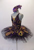 Peacock themed ballet tutu has a black base with beautiful gold & purple embroidered lace designs on the bodice & sheer overlay. The nude straps cross over at the back for good support. The accompanying black pull-on tutu & black briefs create the stunning base. Comes with a large matching hair accessory. Left side