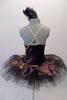 Peacock themed ballet tutu has a black base with beautiful gold & purple embroidered lace designs on the bodice & sheer overlay. The nude straps cross over at the back for good support. The accompanying black pull-on tutu & black briefs create the stunning base. Comes with a large matching hair accessory. Back