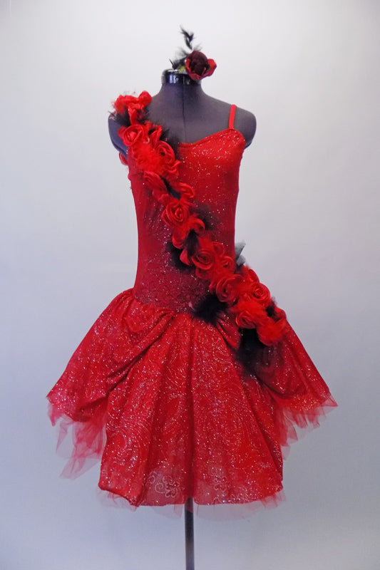 Stunning red romantic tutu is covered with fabulous details.  The red tulle base sits below a red and silver sparkle overlay with gathered bustle sides. An attached 3D sash of red roses and black feathers cascades along the bodice from shoulder to hip.  Comes with a rose hair accessory. Front