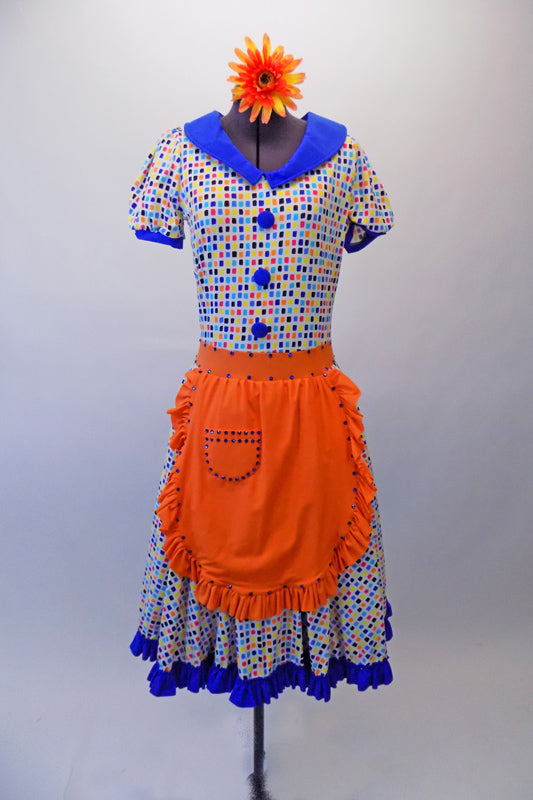 50s housewife themed, pouffe sleeved dress is a white base with colourful squares of blues, yellow & orange. The blue theme is repeated in the collar, sleeve cuffs, buttons & ruffled skirt hem. The orange attached apron compliments the square pattern in the dress with blue crystal accents. Comes with a hair accessory. Front