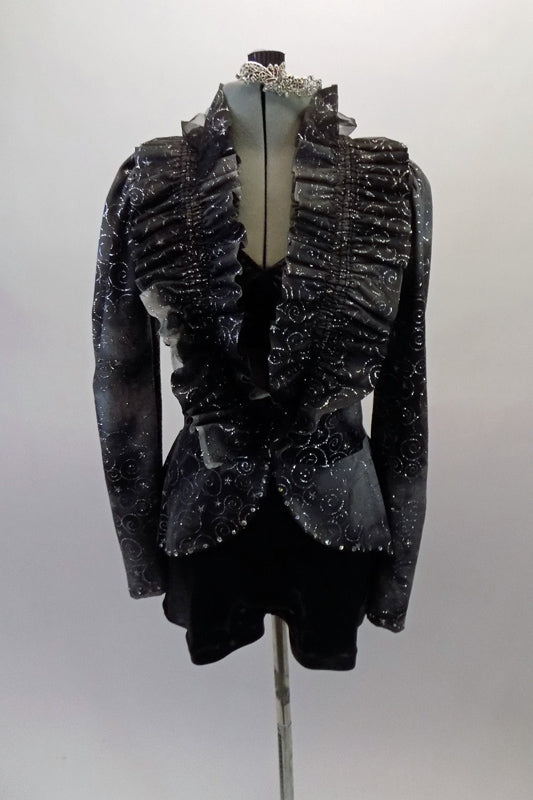 Eclectic costume is a short unitard in shades of grey-black with silver swirled fabric. The top is a faux peplum blazer with a pleated ruffle collar that crosses at the front waist to reveal a black bra beneath. Comes with crystal hair barrette. Front