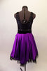 Purple and black tank style dress has a black scoop-neck bodice and black velvet waistband with crystal accents and purple front bow. The attached purple calf length skirt has layers of black tulle for a full petticoat. Comes with floral hair accessory and lace edged purple gauntlets. Back