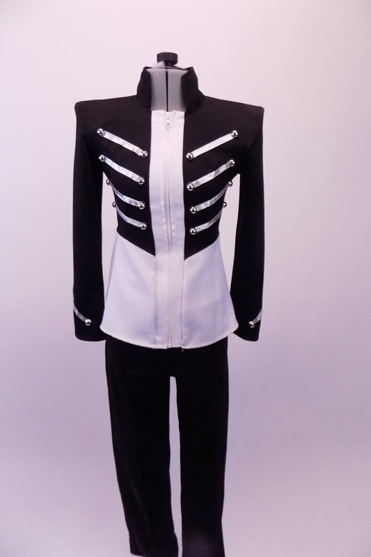 Military style Michael Jackson inspired costume is a black and white front-zip jacket with heavy shaped shoulder cups decorated with silver braiding and ball buttons. The jacket is complemented by black skinny pants. Front